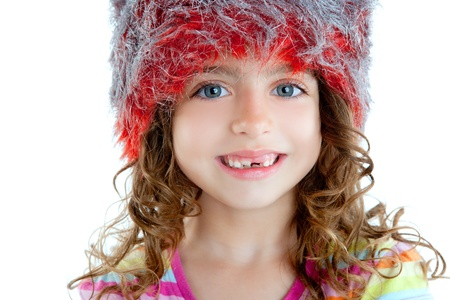Children little girl with winter fur cap red and silver photo