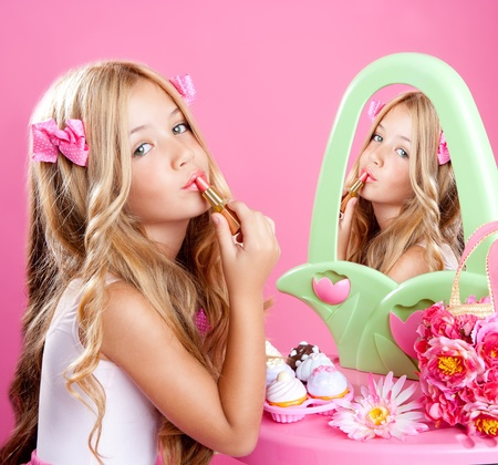 fashion little doll girl in pink vanity mirror with lipstick Stock Photo - 10437600
