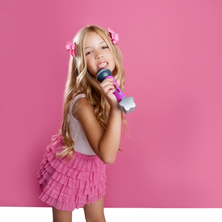 child singing: blond singer star girl like fashion doll singing with mic