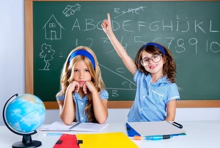 brainy: smart nerd student in classroom raising hand with sad friend