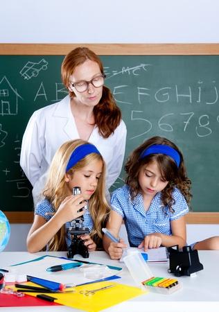 kids class: kids students with nerd teacher woman at science classroom