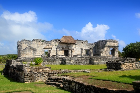 mayan riviera: Ancient Tulum Mayan temple ruins in Mexico Quintana Roo under blue sky Stock Photo