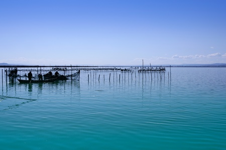 Albufera lake from Valencia Spain wetlands in mediterranean with fishermen tackle photo