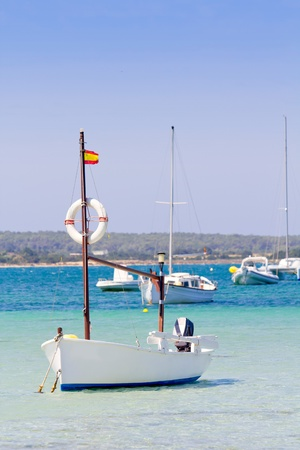 estany des peix in Formentera lake with anchor boats in Mediterranean Spain photo