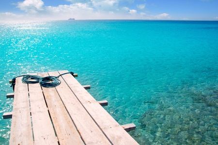 baleares: Formentera beach wood pier over turquoise water from balearic Mediterranean sea paradise