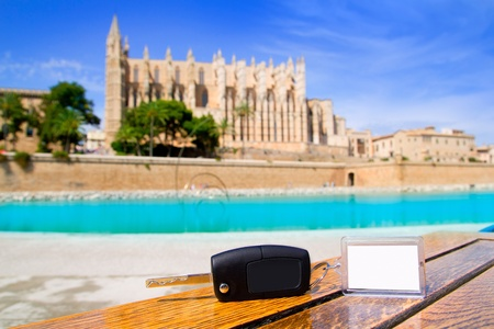 majorca: Car rental keys on wood table with blank paper in Palma de Mallorca cathedral Stock Photo