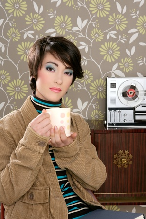 retro fashion 60s woman drinking coffee cup on vintage wallpaper photo