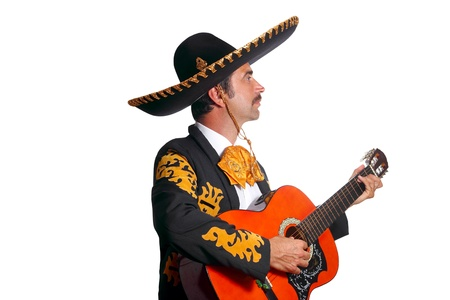 Charro mexican Mariachi playing guitar isolated on white
