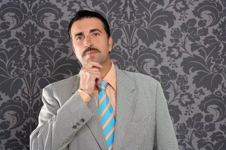 salespeople: mustache retro salesman with vintage suit and pensive gesture in wallpaper
