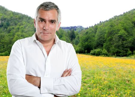 senior man with white shirt in a spring meadow nature mountain Stock Photo - 10494017
