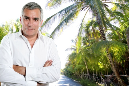 caribbean senior tourist man with white shirt in a tropical palm trees jungle road Stock Photo - 10494025