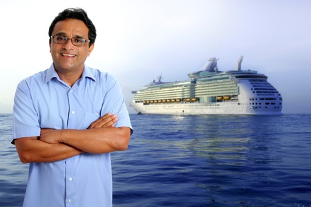 Indian latin tourist man in his sea vacation with a cruise in the background photo