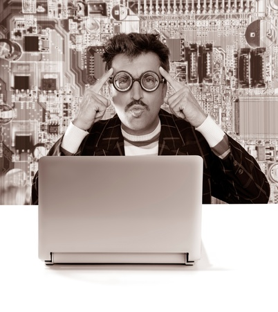 Nerd pensive man with myopic glasses looking for solution on electronics technology problem photo