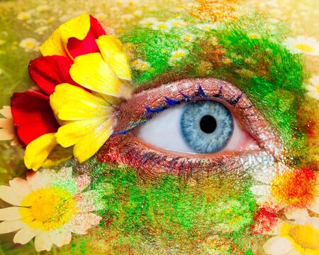 eye shade: blue woman eye makeup inspired in spring with flowers meadow and yellow petals Stock Photo