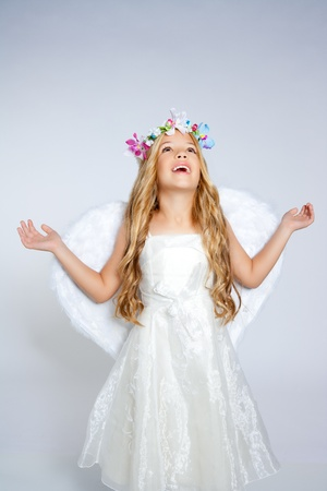 kids dress: Angel children girl with white wings and flowers crown Stock Photo