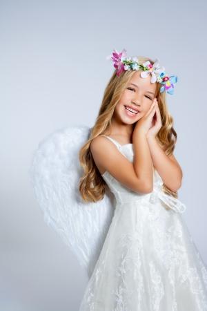 Angel children blond girl with sleeping hands gesture photo