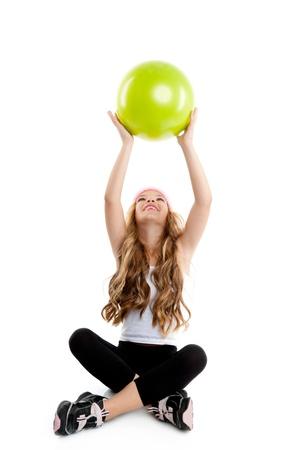 Children gym girl with green yoga ball on pilates exercise photo