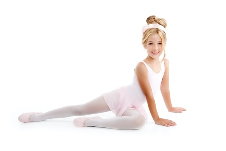 little girl posing: Ballerina children dancer sitting on white Stock Photo