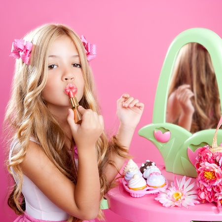 conceit: fashion little doll girl in pink vanity mirror with lipstick