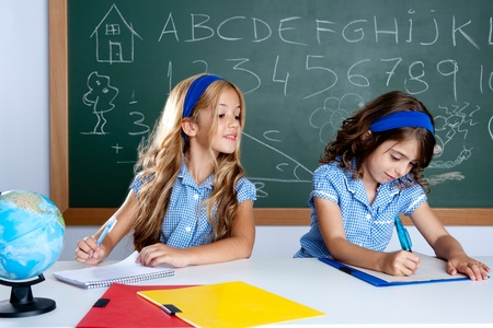 classroom with two kids students cheating on test exam at school Stock Photo - 10494032