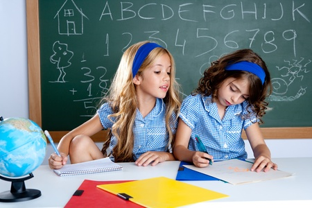 schoolgirls: classroom with two kids students cheating on test exam at school