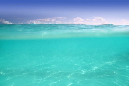 riviera maya: clear waterline caribbean sea underwater and over with blue sky horizon Stock Photo