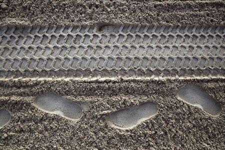 beach sand human footprint human and tyres printed Stock Photo - 10489749