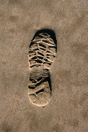 footprint shoe on beach brown sand texture print high view photo