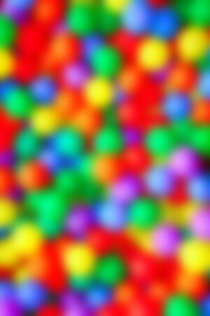 playcentre: blurred colorful balls like out focus color spots background