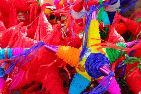 pinata: colorful pinatas with star shape for mexican traditional party celebration