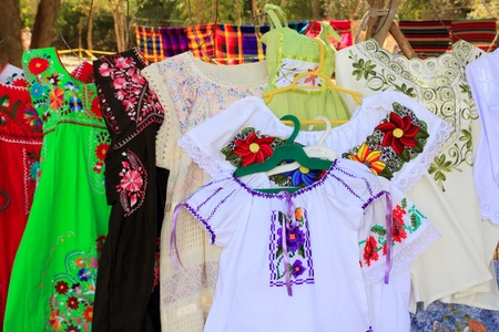 typical: Mayan woman dresses with embroided flowers from Yucatan Mexico