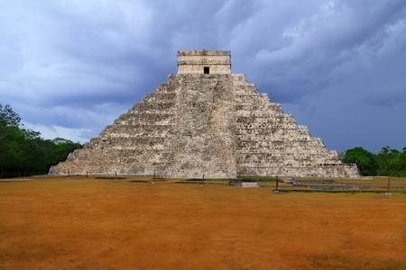riviera maya: Chichen Itza el Castillo Kukulcan Mayan temple cloudy sky Mexico Yucatan