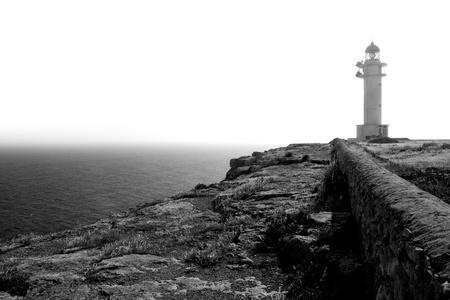 formentera: black and white Barbaria cape lighthouse in Formentera Balearic Island Stock Photo