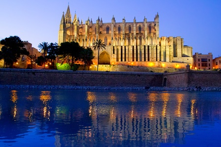 palma: Cathedral of Palma de Mallorca La Seu night view and lake mirrored reflection