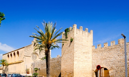 sant: Alcudia Sant Jaume church near roman castle wall Mallorca island in Balearic Spain Stock Photo