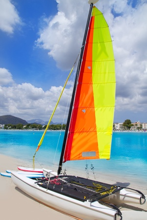 hobie: Beach of Puerto de Alcudia in Mallorca with hobie cat Balearic Islands Spain