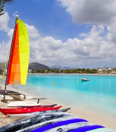 hobie: Beach of Puerto de Alcudia in Mallorca  with hobie cat and kayak on Balearic Islands Spain