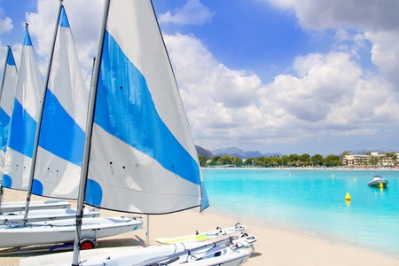 puerto: Beach of Puerto de Alcudia in Mallorca with little sailboats and white sand in Majorca