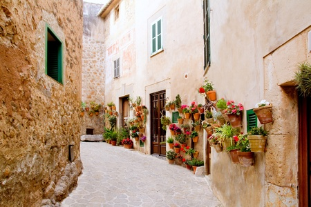 mediterranean houses: Majorca Valldemossa typical village with flower pots in facades at Spain