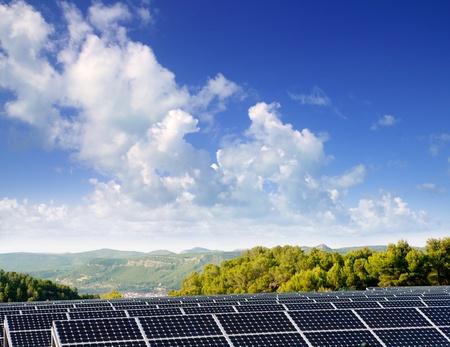 photocell: green energy solar plates to provide mountain valley village Stock Photo