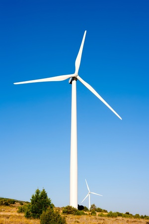 windy energy: aerogenerator windmill in sunny blue sky day