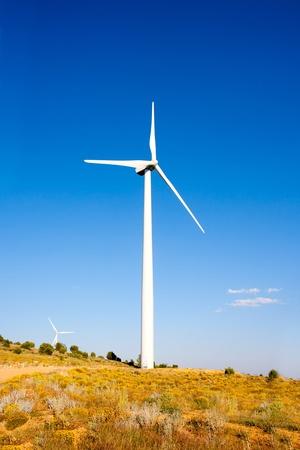 aerogenerator windmill in golden hill blue sky day Stock Photo - 10758135