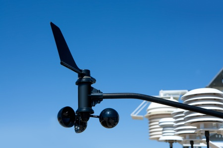 anemometer: anemometer vane in weather station under blue sky