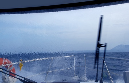 boat perfect storm water splashing in window from indoor photo