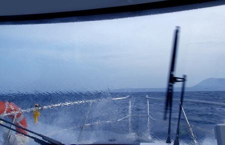 cruiser: boat perfect storm water splashing in window from indoor