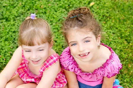 dido: two sister children girls happy in the grass park