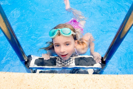 blond little girl in summer swimming pool with goggles  photo