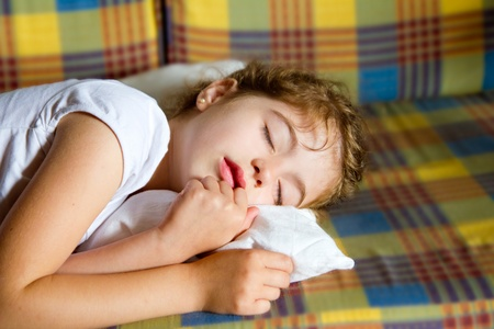 child girl sleeping bed in retro vintage quilt with pillow photo
