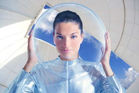 futuristic girl: astronaut beautiful future woman in astronomical observatory Stock Photo