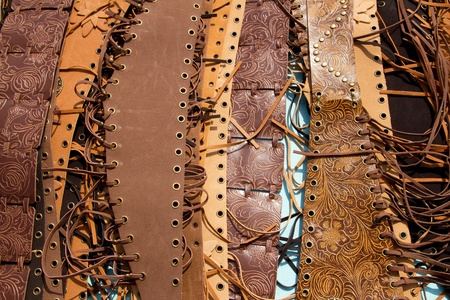 fringes: belt leather goods brown color with fringes in a row Stock Photo